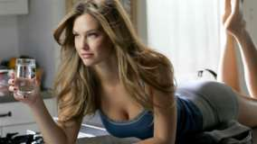 Bar Refaeli Laying Pose In Blue Top N Water Glass In Hand Photoshoot